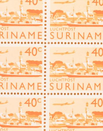 Suriname - CIRCA 1970: A stamp printed in Suriname shows a city, circa 1970