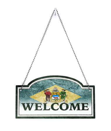 Delaware welcomes you! Old metal sign isolated on white