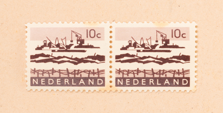 THE NETHERLANDS 1970: A stamp printed in the Netherlands shows the construction of the afsluitdijk, circa 1970 Redactioneel
