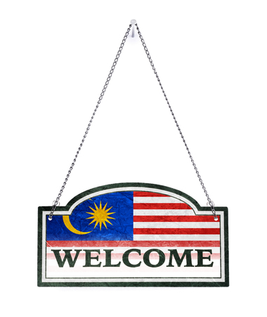 Malaysia welcomes you! Old metal sign isolated on white