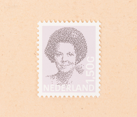 THE NETHERLANDS 1990: A stamp printed in the Netherlands shows queen Beatrix, circa 1990