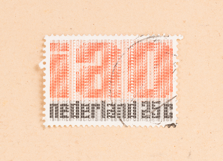 THE NETHERLANDS 1969: A stamp printed in the Netherlands shows a logo of the international labour organization, circa 1969