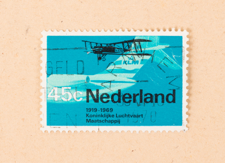 THE NETHERLANDS 1970: A stamp printed in the Netherlands shows 50 years of aviation by KLM, circa 1970 Editoriali