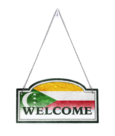 Comoros welcomes you! Old metal sign isolated on white