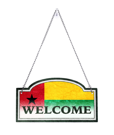Guinea Bissau welcomes you! Old metal sign isolated on white Banco de Imagens