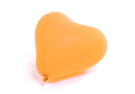 Orange baloon heart, isolated on white background