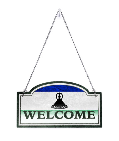 Lesotho welcomes you! Old metal sign isolated on white