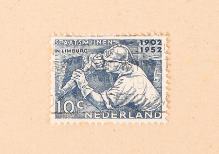 THE NETHERLANDS 1950: A stamp printed in the Netherlands shows the mining of coal, circa 1950