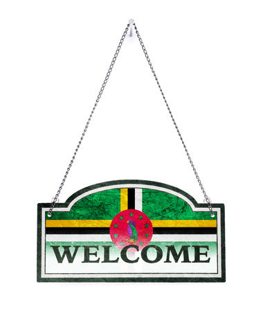 Dominica welcomes you! Old metal sign isolated on white