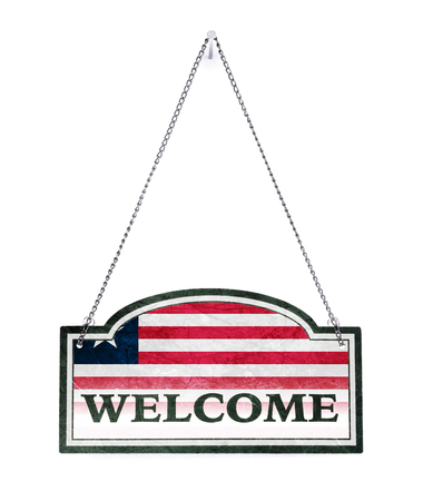 Liberia welcomes you! Old metal sign isolated on white
