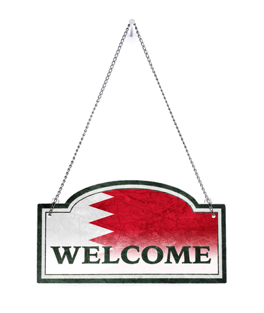 Bahrain welcomes you! Old metal sign isolated on white