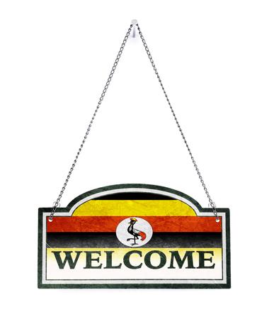 Uganda welcomes you! Old metal sign isolated on white