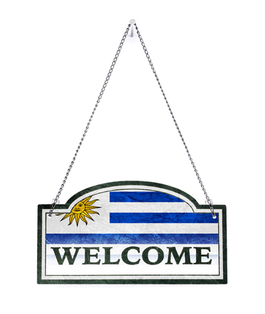 Uruguay welcomes you! Old metal sign isolated on white