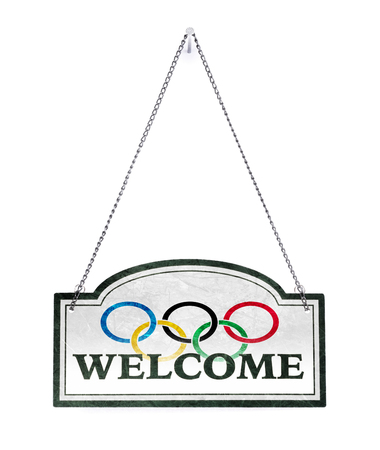 We welcome you! Old metal sign isolated on white - Olympic Rings Redactioneel