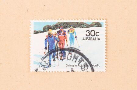 AUSTRALIA - CIRCA 1980: A stamp printed in Australia shows three men skiing in Australia Nordic, circa 1980 写真素材