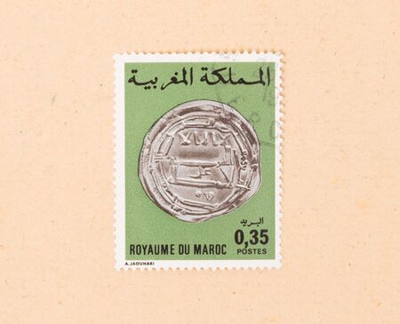 MOROCCO - CIRCA 1980: A stamp printed in Morocco shows an old coin, circa 1980 Фото со стока