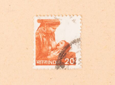 INDIA - CIRCA 1970: A stamp printed in India shows a woman breastfeeding a child, circa 1970