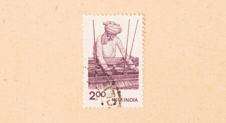 INDIA - CIRCA 1970: A stamp printed in India shows a man working a loom, circa 1970