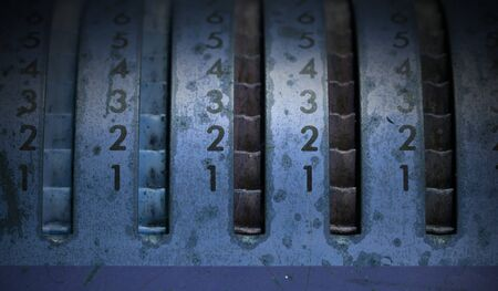 Vintage manual adding machine isolated, selective focus, blue