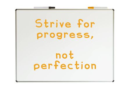 Strive for progress, not perfection, written on a whiteboard, isolated