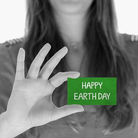 Woman showing a small message: Happy earth day Stock Photo