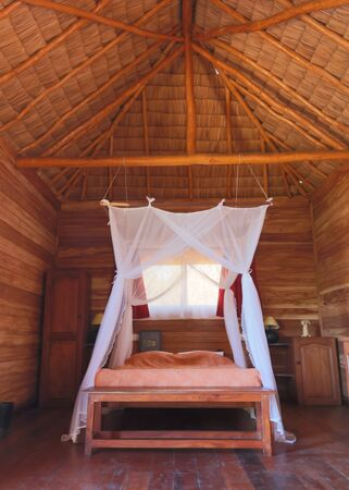 Mosquito net on the bed, to protect tourists while sleeping 写真素材