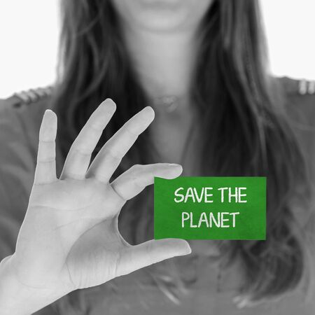 Woman showing a small message: Save the planet