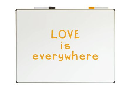 Love is everywhere, written on a whiteboard, isolated