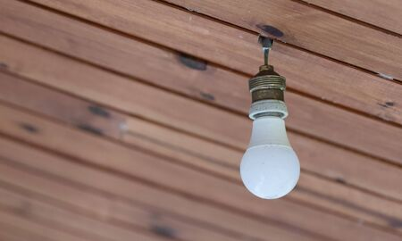 Light bulb from the ceiling, Madagascar, Africa Stock Photo