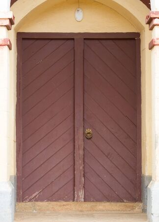 Red double door in an old church