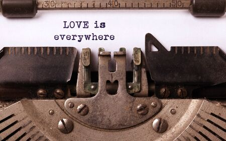 Love is everywhere, written on an old typewriter, vintage