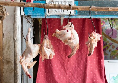 Fresh raw chicken for making dinner, hanging in a market in Madagascar Banco de Imagens
