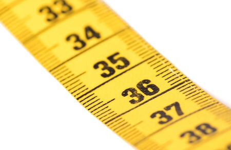 Measuring tape isolated on white, selective focus on 36 Фото со стока
