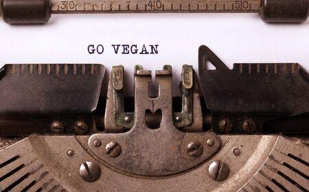 Go Vegan, written on an old typewriter, vintage