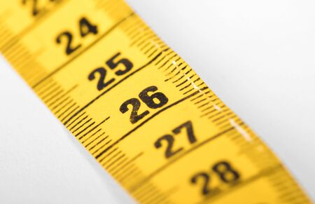 Measuring tape isolated on white, selective focus on 26