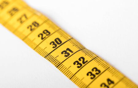 Measuring tape isolated on white, selective focus on 31