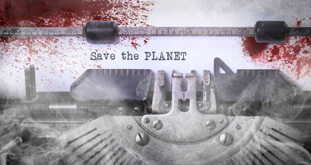 Save the planet, bloody, written on an old typewriter, vintage
