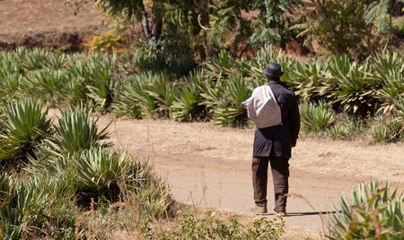 Old man walking on a bad road on Madagascar, Africa