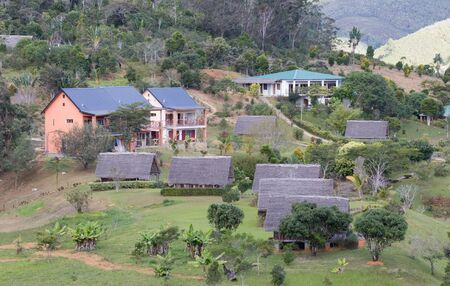 Typical Malagasy landscape, houses in the jungle
