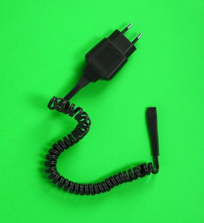 Black charger (220v) isolated on a green background
