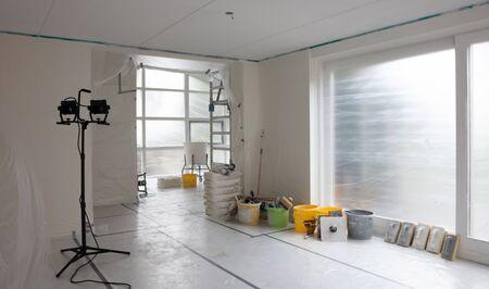 Interior prepared for plastering, eventything covered in plastic, construction LED light Stockfoto