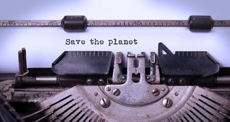 Save the planet, written on an old typewriter, vintage