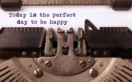 Today is the perfect day to be happy, written on an old typewriter, vintage