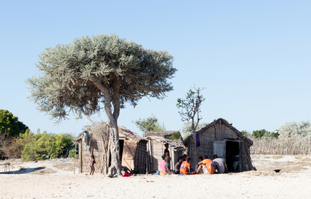 Ifaty, Madagascar on august 1, 2019 - Typical malgasy hut, simple and small, family sitting outside. Sajtókép
