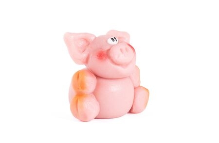 Marzipan pig, ready to be eaten, isolated on white