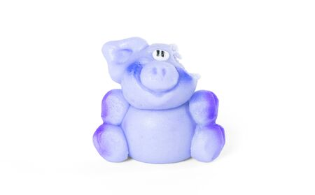 Marzipan pig, ready to be eaten, one bite already, isolated on white