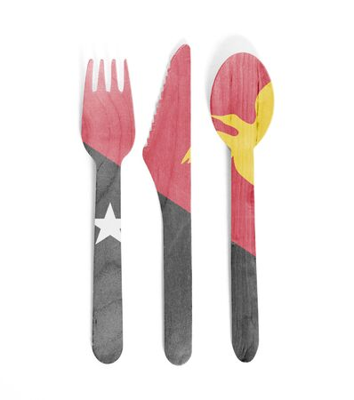 Eco friendly wooden cutlery - Plastic free concept - Isolated - Flag of Papua New Guinea