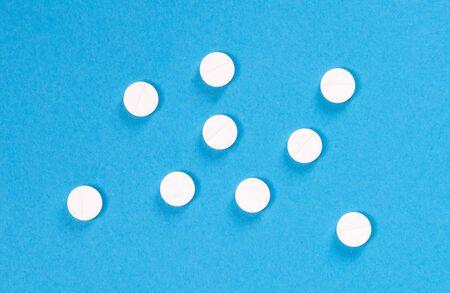 Medicine - Trying medication, isolated on blue background