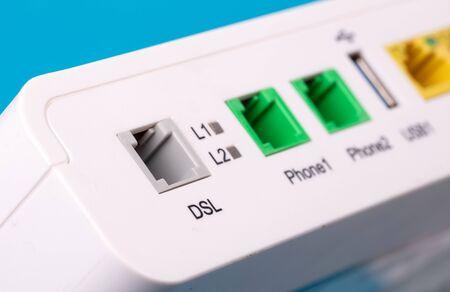 Desktop Home ADSL modem on a blue background back view, selective focus