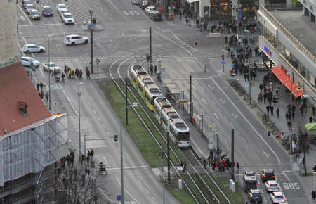 BERLIN, GERMANY on December 31, 2019: People pass tram ways in the city centre of Berlin. Editorial